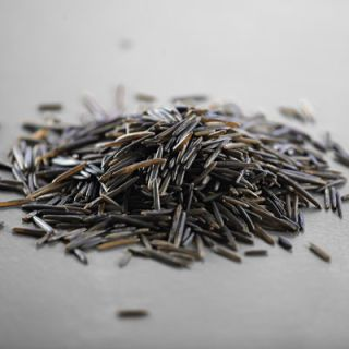 Inte a member of the rice family at all but the seed of an aquatic grass native to the cold regions of North America. Wild rice has a strong nutty taste and can be expensive, so it is best used combined with brown and white rices in pilafs, stuffings and salads.