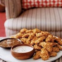 Mi've cut the fat from these irresistibly crispy chicken fingers by baking them in the oven instead of deep frying.