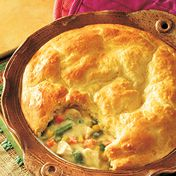Steka poultry and vegetables are paired in a creamy sauce and topped with a golden biscuit crust.